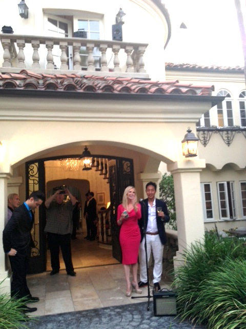 Creator of DESTINATION LUXURY, David Christopher Lee, and the hostess of the event share a moment with the guests.
