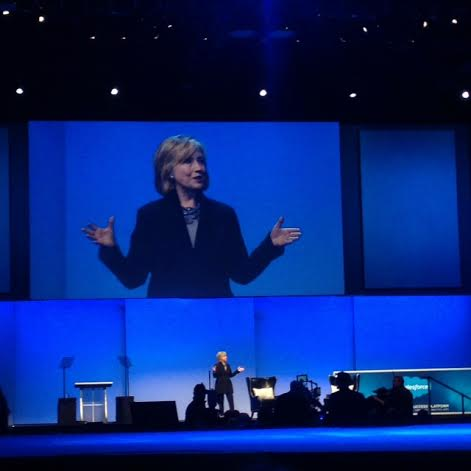 Hillary Rodham Clinton speaking about the importance of dialogue between leaders and giving back.