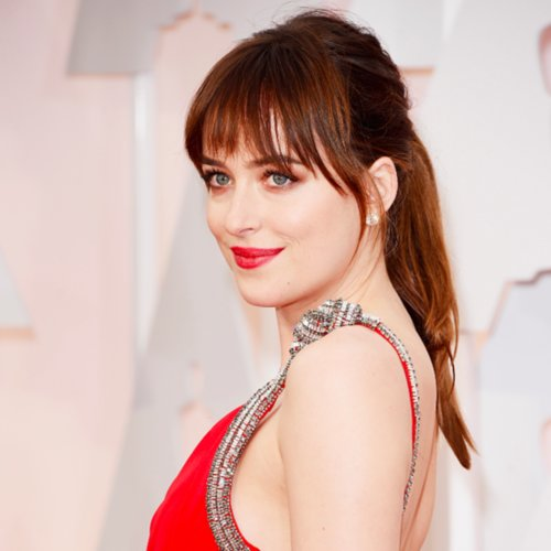 50 Shades of Grey Actress Dakota Johnson in White Gold Forevermark Diamond bracelets, earrings, and ring.